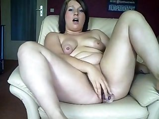 Chubby German girl fucks the brush ass and pussy with dildos