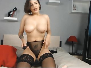 Beautiful Russian brunette oils the brush body for you