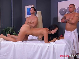 Rough rub-down and a gang bang for an oiled up brunette Roxy Lane